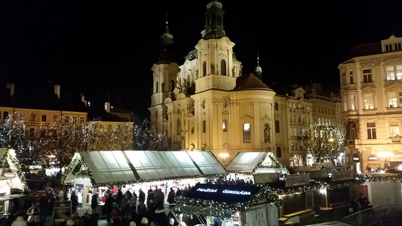 st nicholas church old town with christmas market at night