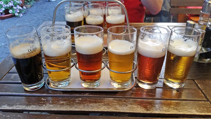 flight of beer on a wooden table