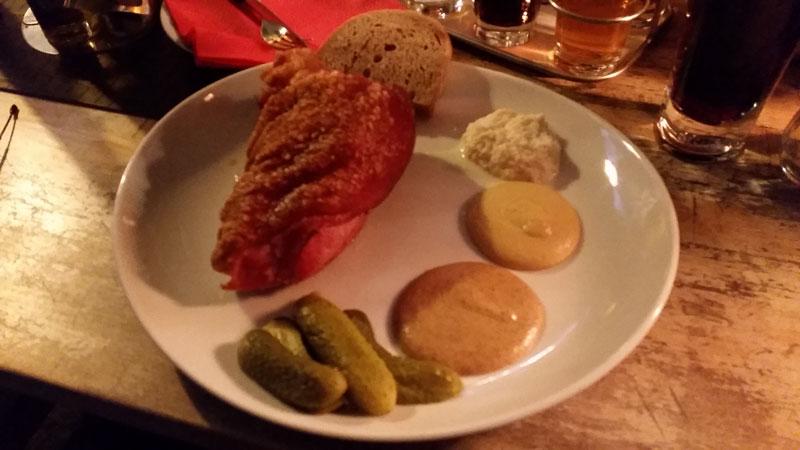 prague pork knuckle boneless on a plate with mustard and horseradish