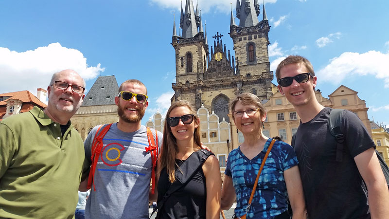 group of tourists on prague old town square