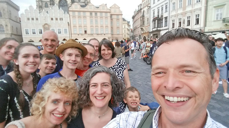 family on prague old town square