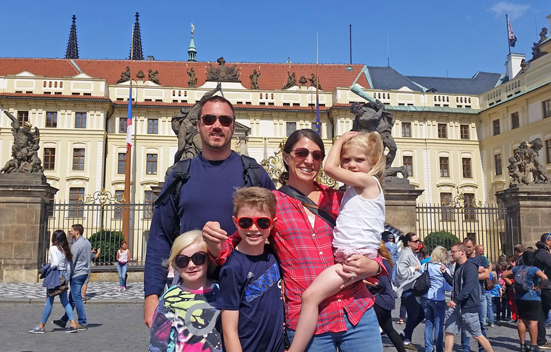 family in front of prague castle