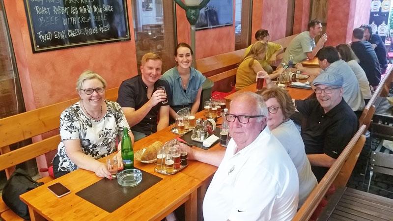 group eating czech food at a prague restaurant